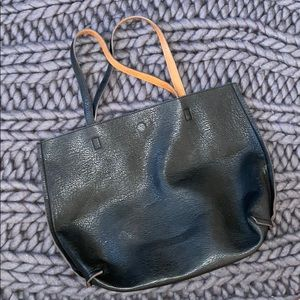 Reversible carry all faux leather bag